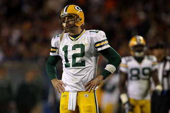 CHICAGO - SEPTEMBER 27:  Aaron Rodgers #12 of  the Green Bay Packers looks on dejected against the Chicago Bears at Soldier Field on September 27, 2010 in Chicago, Illinois.  (Photo by Jonathan Daniel/Getty Images)