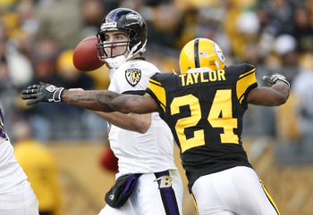 PITTSBURGH - DECEMBER 27:  Ike Taylor #24 of the Pittsburgh Steelers sacks Joe Flacco #5 of the Baltimore Ravens on December 27, 2009 at Heinz Field in Pittsburgh, Pennsylvania. Pittsburgh won the game 23-20.  (Photo by Gregory Shamus/Getty Images)