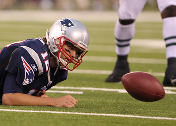 EAST RUTHERFORD, NJ - SEPTEMBER 19: Tom Brady #12 of the New England Patriots loses the ball after being sacked against  the New York Jets during their  game on September 19, 2010 at the New Meadowlands Stadium  in East Rutherford, New Jersey.  (Photo by