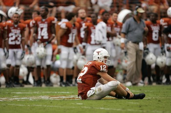 AUSTIN, TX - SEPTEMBER 29:  Quarterback Colt McCoy #12 of the Texas Longhorns sits in the middle of the field after throwing an incomplete pass against the Kansas State Wildcats late in the fourth quarter on September 29, 2007 at Darrell K Royal-Texas Mem