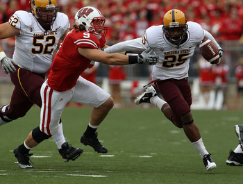 MADISON, WI - SEPTEMBER 18: Deantre Lewis #25 of the Arizona State Sun Devils tries to break away from Blake Sorensen #9 of the Wisconsin Badgers at Camp Randall Stadium on September 18, 2010 in Madison, Wisconsin. Wisconsin defeated Arizona State 20-19.