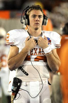 PASADENA, CA - JANUARY 07:  Quarterback Colt McCoy #12 of the Texas Longhorns looks on during the sideline in the fourth quarter against the Alabama Crimson Tide in the Citi BCS National Championship game at the Rose Bowl on January 7, 2010 in Pasadena, C