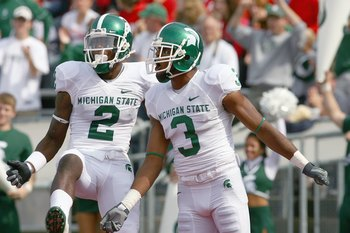 MADISON, WI - SEPTEMBER 26: B.J. Cunningham #3 and Mark Dell #2 of the Michigan State Spartans celebrate on te field against the Wisconsin Badgers on September 26, 2009 at Camp Randall Stadium in Madison, Wisconsin. (Photo by Jonathan Daniel/Getty Images)