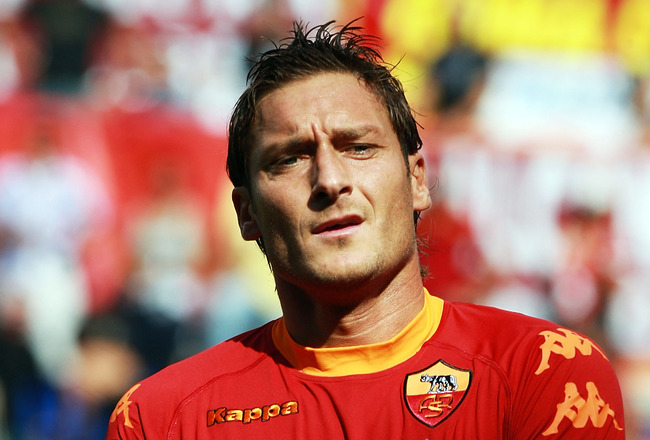 ROME - SEPTEMBER 19:  Francesco Totti of AS Roma looks on during the Serie A match between AS Roma and Bologna FC at Stadio Olimpico on September 19, 2010 in Rome, Italy.  (Photo by Paolo Bruno/Getty Images)