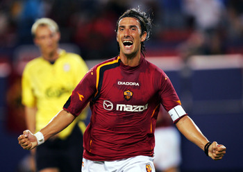 EAST RUTHERFORD, NJ - AUGUST 3:  Marco Del Vecchio #9 of AS Roma celebrates after scoring a goal against Liverpoolduring the ChampionsWorld Series at Giant Stadium August 3, 2004 in East Rutherford, New Jersey.  (Photo by Ezra Shaw/Getty Images)