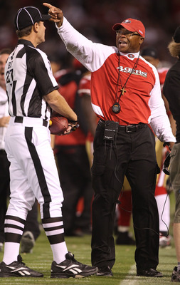 SAN FRANCISCO - SEPTEMBER 20:  Head coach Mike Singletary of the San Francisco 49er talks to a referee against the New Orleans Saints during an NFL game at Candlestick Park on September 20, 2010 in San Francisco, California.(Photo by Jed Jacobsohn/Getty I