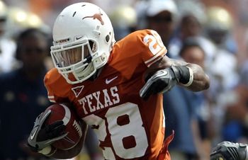 AUSTIN, TX - SEPTEMBER 25:  Running back Fozzy Whittaker #28 of the Texas Longhorns runs the ball against the UCLA Bruins at Darrell K Royal-Texas Memorial Stadium on September 25, 2010 in Austin, Texas.  (Photo by Ronald Martinez/Getty Images)