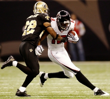 NEW ORLEANS - NOVEMBER 2:  Tracy Porter #22 of the New Orleans Saints stops Michael Jenkins #21 of the Atlanta Falcons during the game at the Louisiana Superdome on November 2, 2009 in New Orleans, Louisiana. (Photo by Chris Graythen/Getty Images)