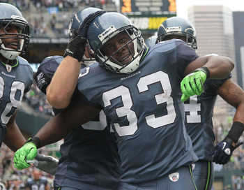 SEATTLE - SEPTEMBER 26:  Kick returner Leon Washington #33 of the Seattle Seahawks celebrates with teammates after scoring a touchdown on a 101 yard kickoff return in the third quarter against the San Diego Chargers at Qwest Field on September 26, 2010 in