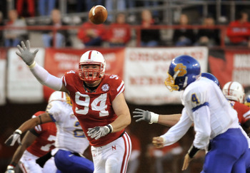LINCOLN, NE - SEPTEMBER 25: Defensive tackle Jared Crick #94 of the Nebraska Cornhuskers tries to bat down a pass from  quarterback Thomas O'Brien #4 of the South Dakota State Jackrabbitsduring first half action of their game at Memorial Stadium on Septem
