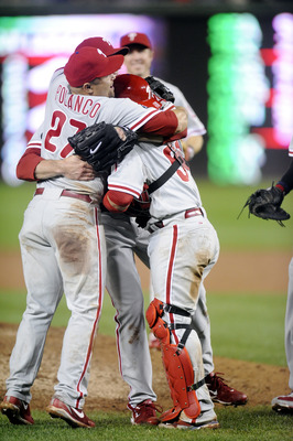 WASHINGTON - SEPTEMBER 27:  Placidio Planico #27 and Carlos Ruiz ##51 celebrate clinching the National League east title after a baseball game against the Washington Nationals on September 27, 2010 at Nationals Park in Washington, D.C. The Phillies won 8-