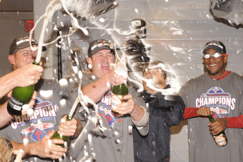 WASHINGTON - SEPTEMBER 27:  (L-R) Mike Sweeney, Brian Schneider and Ben Francisco of the Philadelphia Phillies celebrate clinching the National League east title after a baseball game against the Washington Nationals on September 27, 2010 at Nationals Par
