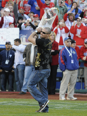 PHILADELPHIA, PA - OCTOBER 31: Philadelphia Phillies Shane Victorino carries the World Series Trophy at a victory rally at Citizens Bank Park October 31, 2008 in Philadelphia, Pennsylvania. The Phillies defeated the Tampa Bay  Rays to win their first Worl