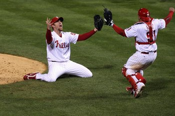 PHILADELPHIA - OCTOBER 29:  Brad Lidge #54 (L) and Carlos Ruiz #51 of the Philadelphia Phillies celebrate the final out of their 4-3 win to win the World Series against the Tampa Bay Rays during the continuation of game five of the 2008 MLB World Series o