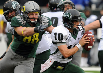 Oregon DT Brandon Bair needs to slow down Stanford QB Andrew Luck.