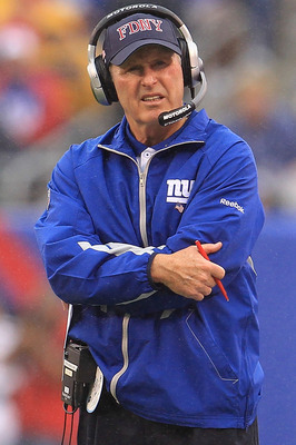 EAST RUTHERFORD, NJ - SEPTEMBER 12:  Head coach Tom Coughlin of the New York Giants watches on against the Carolina Panthers during the NFL season opener at New Meadowlands Stadium on September 12, 2010 in East Rutherford, New Jersey.  (Photo by Chris McG