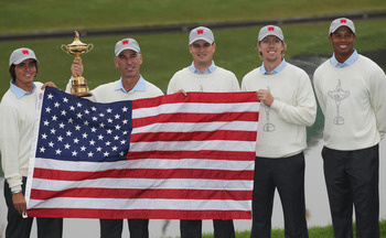 NEWPORT, WALES - SEPTEMBER 28:  (L-R) Rickie Fowler, Team Captain Corey Pavin, Zach Johnson, Hunter Mahan and Tiger Woods pose with the trophy and the American flag during the USA Team Photocall prior to the 2010 Ryder Cup at the Celtic Manor Resort on Se