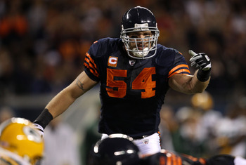CHICAGO - SEPTEMBER 27:  Brian Urlacher #54 of the Chicago Bears gestures at the line of scrimmage against the Green Bay Packers at Soldier Field on September 27, 2010 in Chicago, Illinois.  (Photo by Jonathan Daniel/Getty Images)