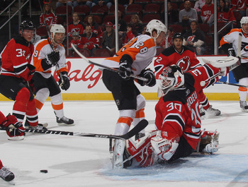 NEWARK, NJ - SEPTEMBER 28: Claude Giroux #28 of the Philadelphia Flyers is stopped by Martin Brodeur #30 of the New Jersey Devils at the Prudential Center on September 28, 2010 in Newark, New Jersey. (Photo by Bruce Bennett/Getty Images)