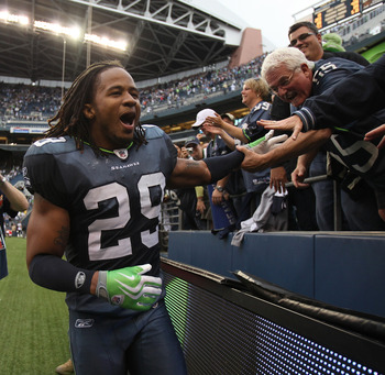SEATTLE - SEPTEMBER 26:  Free safety Earl Thomas #29 of the Seattle Seahawks celebrates with fans after the Seahawks defeated the San Diego Chargers 27-20 at Qwest Field on September 26, 2010 in Seattle, Washington. (Photo by Otto Greule Jr/Getty Images)