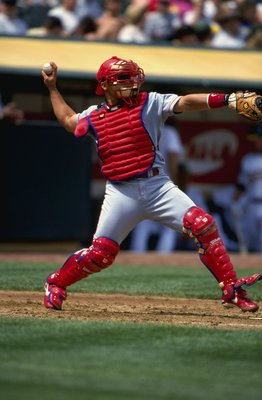 18 Apr 1999:  Catcher Ivan Rodriguez #7 of the Texas Rangers  throws the ball during the game against the Oakland Athletics at the Oakland Coliseum in Oakland, California. The Rangers defeated the Athletics 6-2. Mandatory Credit: Jed Jacobsohn  /Allsport