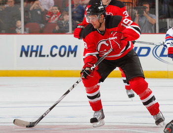 NEWARK, NJ - SEPTEMBER 25: Travis Zajac #19 of the New Jersey Devils during a preseason hockey game against the New York Rangers at the Prudential Center on September 25, 2010 in Newark, New Jersey.  (Photo by Paul Bereswill/Getty Images)
