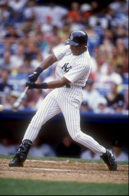 26 Aug 1998:  Bernie Williams #51 of the New York Yankees swings at a pitch during a game against the Anaheim Angels at Yankee Stadium in the Bronx, New York. The Angels defeated the Yankees 6-4.