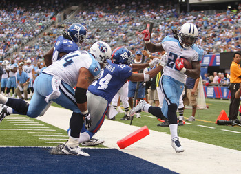 EAST RUTHERFORD, NJ - SEPTEMBER 26:  Chris Johnson #28 of the Tennessee Titans is pushed out of bounds at the endzone by Terrell Thomas #24 of the New York Giants at New Meadowlands Stadium on September 26, 2010 in East Rutherford, New Jersey.  (Photo by