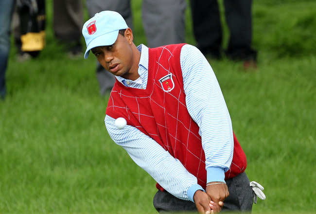 NEWPORT, WALES - SEPTEMBER 28:  Tiger Woods of the USA chips during a practice round prior to the 2010 Ryder Cup at the Celtic Manor Resort on September 28, 2010 in Newport, Wales.  (Photo by Andy Lyons/Getty Images)