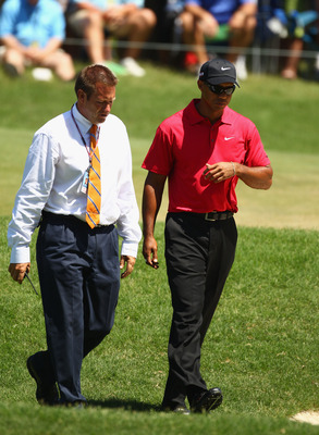 PONTE VEDRA BEACH, FL - MAY 09:  (L-R) PGA TOUR Rules Official Stephen Cox talks with Tiger Woods on the seventh hole where Woods withdraws due to a neck injury during the final round of THE PLAYERS Championship held at THE PLAYERS Stadium course at TPC S