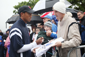 NEWPORT, WALES - SEPTEMBER 29:  Tiger Woods signs autographs for fans during a practice round prior to the 2010 Ryder Cup at the Celtic Manor Resort on September 29, 2010 in Newport, Wales.  (Photo by Jamie Squire/Getty Images)