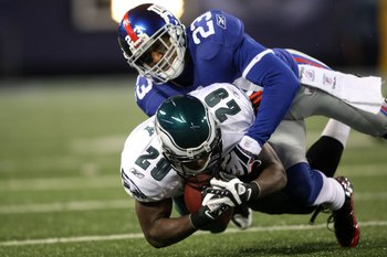 EAST RUTHERFORD, NJ - DECEMBER 13:  LeSean McCoy #29 of the Philadelphia Eagles is tackled by Corey Webster #23 of the New York Giants at Giants Stadium on December 13, 2009 in East Rutherford, New Jersey.  (Photo by Nick Laham/Getty Images)