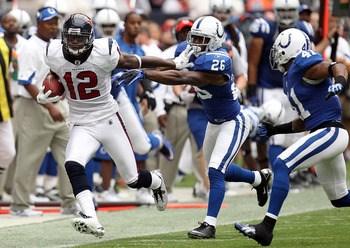 HOUSTON - SEPTEMBER 12:  Wide receiver Jacoby Jones #12 of the Houston Texans runs the ball past Kelvin Hayden #26 of the Indianapolis Colts at Reliant Stadium on September 12, 2010 in Houston, Texas.  (Photo by Ronald Martinez/Getty Images)