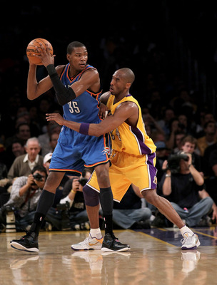 LOS ANGELES - APRIL 20: Kevin Durant #35 of the Oklahoma City Thunder controls the ball against Kobe Bryant #24 of the Los Angeles Lakers during  Game Two of the Western Conference Quarterfinals of the 2010 NBA Playoffs on April 20, 2010 at Staples Center