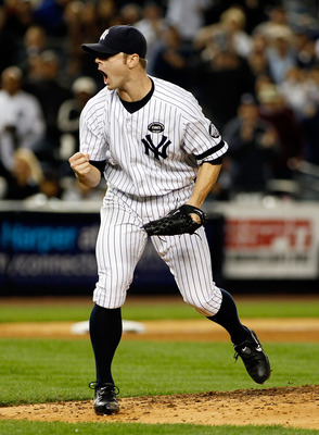 NEW YORK - SEPTEMBER 26:  David Robertson #30 of the New York Yankees pumps his fist after striking out Lars Anderson (not shown) of the Boston Red Sox in the seventh-inning on September 26, 2010 at Yankee Stadium in the Bronx borough of New York City.  (
