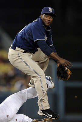 LOS ANGELES, CA - SEPTEMBER 21:  Miguel Tejada #10 of the San Diego Padres jumps away from the slide of Jamey Carroll #14 of the Los Angeles Dodgers to complete a double play during the first inning at Dodger Stadium on September 21, 2010 in Los Angeles,