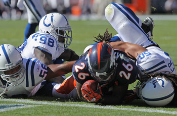 DENVER - SEPTEMBER 26:  Running back Laurence Maroney #26 of the Denver Broncos is stopped short of the goal line on fourth down and one yard to go by Philip Wheeler #50, Gary Brackett #58 and Robert Mathis #98 of the Indianapolis Colts at INVESCO Field a