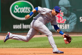 ST. LOUIS - AUGUST 15: Aramis Ramirez #16 of the Chicago Cubs fields a ground ball against the St. Louis Cardinals at Busch Stadium on August 15, 2010 in St. Louis, Missouri.  The Cubs beat the Cardinals 9-7.  (Photo by Dilip Vishwanat/Getty Images)