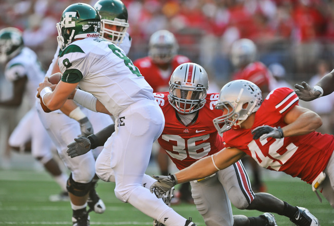 COLUMBUS, OH - SEPTEMBER 25:  Brian Rolle #36 and Andrew Sweat #42 of the Ohio State Buckeyes chase after quarterback Alex Gillett #8 of the Eastern Michigan Eagles at Ohio Stadium on September 25, 2010 in Columbus, Ohio.  Ohio State won 73-20. (Photo by