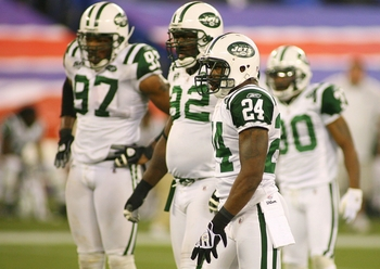 TORONTO - DECEMBER 3: Darrelle Revis #24, Shaun Ellis #92 and Calvin Pace #97 of the New York Jets gets set on defense against the Buffalo Bills at Rogers Centre on December 3, 2009 in Toronto, Canada. The Jets won 19-16.  (Photo by Rick Stewart/Getty Ima