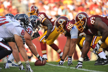 LANDOVER, MD - SEPTEMBER 19:  Chris Myers #55 of the Houston Texans prepares to snap the ball against the Washington Redskins at FedExField on September 19, 2010 in Landover, Maryland. The Texans defeated the Redskins in overtime 30-27. (Photo by Larry Fr