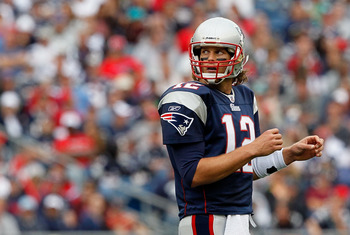FOXBORO, MA - SEPTEMBER 26:  Tom Brady #12 of the New England Patriots checks the clock against the Buffalo Bills in the second half at Gillette Stadium on September 26, 2010 in Foxboro, Massachusetts. (Photo by Jim Rogash/Getty Images)