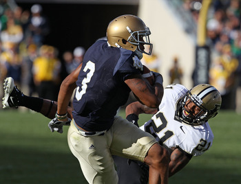 SOUTH BEND, IN - SEPTEMBER 04: Michael Floyd #3 of the Notre Dame Fighting Irish makes a catch under pressure from Ricardo Allen #21 of the Purdue Boilermakers at Notre Dame Stadium on September 4, 2010 in South Bend, Indiana. Notre Dame defeated Purdue 2