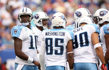 EAST RUTHERFORD, NJ - SEPTEMBER 26:  Vince Young #10 of the Tennessee Titans calls the play in the huddle during a game against the New York Giants at New Meadowlands Stadium on September 26, 2010 in East Rutherford, New Jersey.  (Photo by Mike Ehrmann/Ge