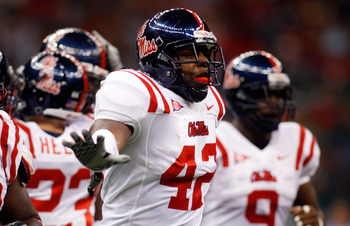 NEW ORLEANS - SEPTEMBER 11:  D.T. Shackelford #43 of the Ole Miss Rebels celebrates on the field after a sack against the Tulane Green Wave at the Louisiana Superdome on September 11, 2010 in New Orleans, Louisiana.  (Photo by Chris Graythen/Getty Images)