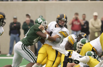 EAST LANSING, MI - OCTOBER 13:  Safety Thomas Wright #43 of the Michigan State Spartans sacks quarterback Kyle McCann #4 of the Iowa Hawkeyes during the Big Ten Conference football game on October 13, 2001 at Spartan Stadium in East Lansing, Michigan. The