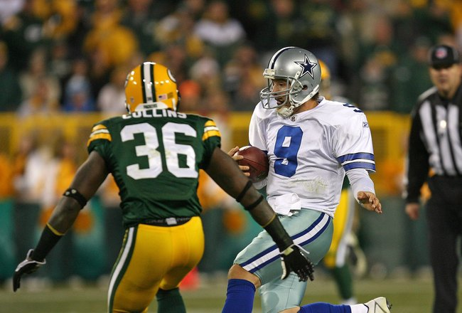 GREEN BAY, WI - NOVEMBER 15: Tony Romo #8 of the Dallas Cowboys runs for a first down as Nick Collins #36 of the Green Bay Packers closes in at Lambeau Field on November 15, 2009 in Green Bay, Wisconsin. The Packers defeated the Cowboys 17-7. (Photo by Jo