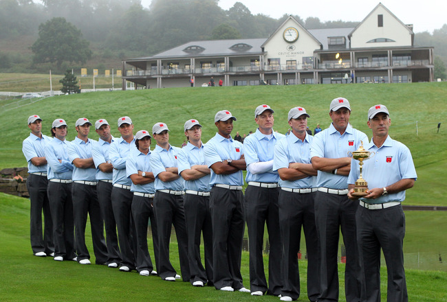 NEWPORT, WALES - SEPTEMBER 28:  (L-R)  Matt Kuchar, Bubba Watson, Dustin Johnson, Stewart Cink, Jeff Overton, Rickie Fowler, Zach Johnson, Hunter Mahan, Tiger Woods, Jim Furyk, Steve Stricker, Phil Mickelson and Team Captain Corey Pavin pose with the trop