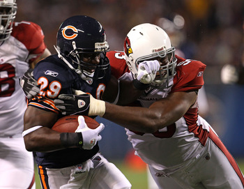 CHICAGO - AUGUST 28: Chester Taylor #29 of the Chicago Bears is hit by Calais Campbell #93 of the Arizona Cardinals during a preseason game at Soldier Field on August 28, 2010 in Chicago, Illinois. The Cardinals defeated the Bears 14-9. (Photo by Jonathan