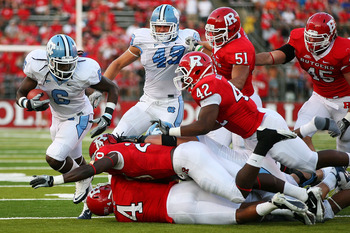 NEW BRUNSWICK, NJ - SEPTEMBER 25:  Anthony Elzy #6 (L) of the North Carolina Tar Heels breaks runs past the Rutgers Scarlet Knights defense during the third quarter at Rutgers Stadium on September 25, 2010 in New Brunswick, New Jersey.  (Photo by Andrew B